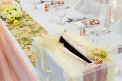 Table set with gift box Royalty Free Stock Image