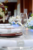 Table Set With Glass. And flowers Stock Photo