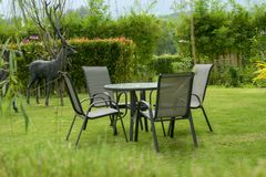 Table set in the grass. royalty free stock images