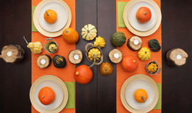 Table set with halloween autumn pumpkins on thanksgiving day Royalty Free Stock Images
