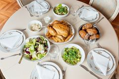 Table set for holiday lunch. Formal lunch with chicken and salad royalty free stock photos