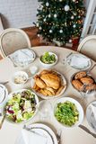 Table set for holiday lunch. Formal lunch with chicken and salad Stock Image