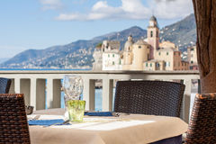 Table set in Italian restaurant in front of Camogli Bay, near Ge Royalty Free Stock Images