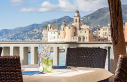 Table set in Italian restaurant in front of Camogli Bay, near Ge Stock Photography