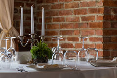 Table set in a luxurious restaurant with brick wall background Royalty Free Stock Images