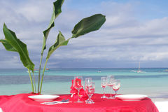 Table set for meal on beach Stock Photos