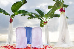 Table set for meal on beach Royalty Free Stock Image