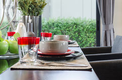 Table set in modern dinnig room Royalty Free Stock Images