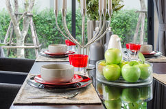 Table set in modern dinnig room Royalty Free Stock Photo
