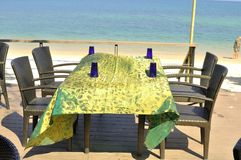 Table set near the Datai Bay beach, Langkawi, Malaysia. The beach is located in an idyllic tropical setting on Malaysia`s Langkawi Island, is cosily tucked away Royalty Free Stock Photos