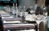 Table set for official dinner. Focus on glasses Stock Photo