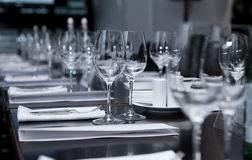 Table set for official dinner. Focus on glasses Royalty Free Stock Images