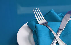 Table Set for One. A colorful table set with plate, knife, fork and napkin Stock Image