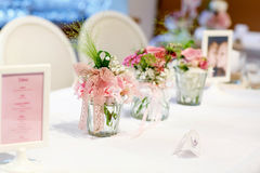 Table set in pink and white for wedding or event party. Stock Photography