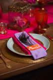A table set with plate decorate in purple and pink Stock Photo