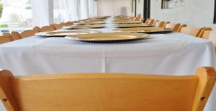Table set for rehearsal dinner. Royalty Free Stock Images