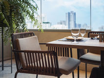 Table set Restaurant Dining with City scape view. Background Royalty Free Stock Image