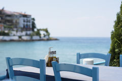 Table set in restaurant on seaside Royalty Free Stock Photo