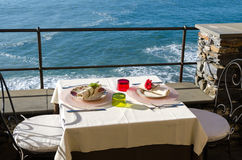 Table set on the sea Stock Photos