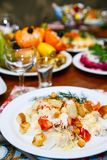 Christmas. Table set, side view. Salad with chicken breast, bell peppers and crackers. Table set, side view. Salad with chicken breast, bell peppers and Royalty Free Stock Photography