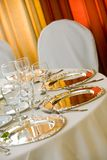 A table set with silver platters Royalty Free Stock Photo