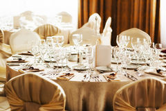 Table set for a special occasion. Table set for wedding reception or party with beige decorations Stock Image