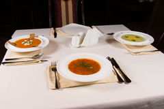 Table set with three different bowls of soup Royalty Free Stock Photo