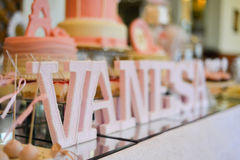 Table set up for a  baby girl birthday party with name Vanesa Stock Photography