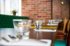 Table set up in Restaurant. Interior of modern restaurant , empty glass on table royalty free stock photo