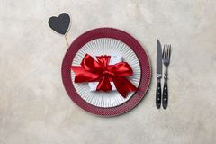 Table set for Valentine`s day dinner with gift and table wear royalty free stock photography