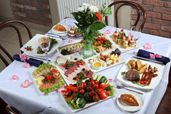 A table set with a variety of dishes Royalty Free Stock Photo
