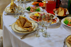 Table set for wedding or another catered event dinner. Decorated table in the restaurant Royalty Free Stock Photography