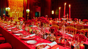 Table set for wedding or another catered event. Dinner in red colors Stock Photography