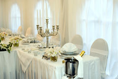 Table set for a wedding dinner. Decorated with flowers and candles Royalty Free Stock Images
