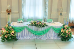 Table set for a wedding dinner. With flowers Royalty Free Stock Image
