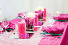 Table set for wedding or event party in pink, rose and purple Stock Photo