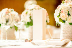 Table Set For Wedding Party. Close-up of a floral wedding table decoration with menu Royalty Free Stock Images
