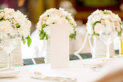 Table Set For Wedding Party. Close-up of a floral wedding table decoration with menu Stock Images