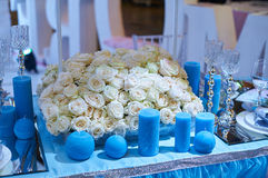 Table set for wedding reception with candles and flower bouquets Royalty Free Stock Photos