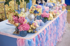 Table set for wedding reception with candles and flower bouquets Stock Image