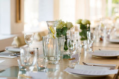 Table set in white for wedding or event party Royalty Free Stock Image