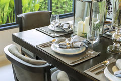 Table set on wood dinning table Royalty Free Stock Images