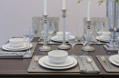 Table set on wooden table in luxury dinning room Royalty Free Stock Photo
