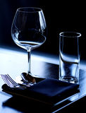 Table Setting. Wine glass, water glass and flatware setting for fine dining Stock Photos