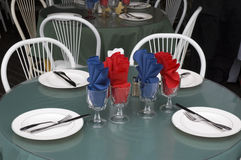 Table setting. Four glasses napkins knife fork Stock Photography