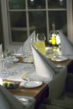 Table setting. In a restaurant by night with white napkins and glasses stock photo