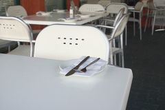 Table Setting. Plate and napkins set out on restaurant table stock photography