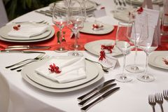 Table setting. With a plate and a napkin (in red and white Stock Image