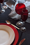 Table setting. Modern table setting in red and black Royalty Free Stock Images
