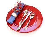 Table Setting. Elegant table setting in red and blue, with fresh sprigs of leaves and berries Stock Images